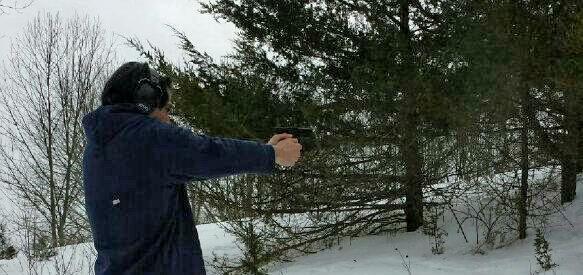 Attorney Mike Giaramita target shooting with family on a farm.